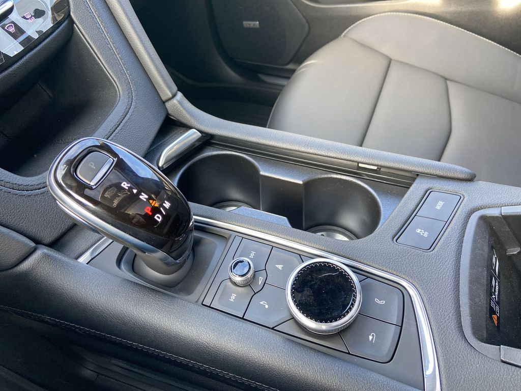 White[Crystal White Tricoat] 2021 Cadillac XT5 Premium Sport Center Console Photo in Calgary AB