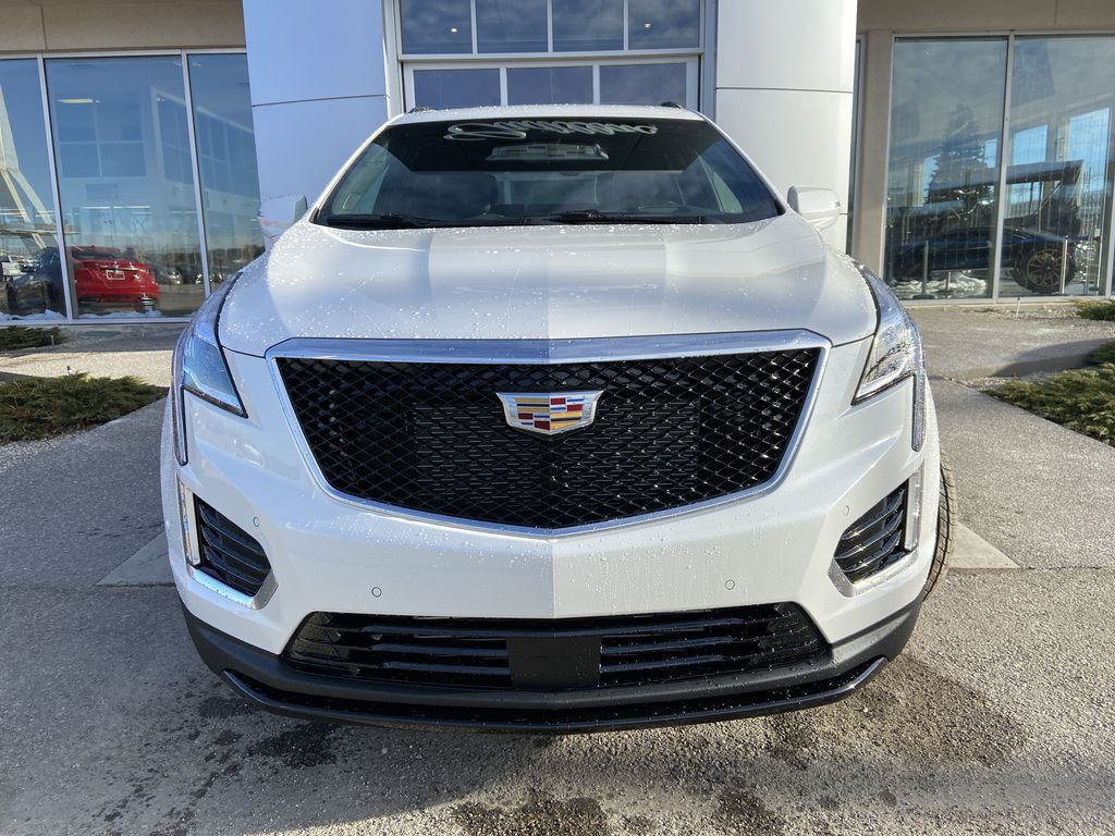 White[Crystal White Tricoat] 2021 Cadillac XT5 Premium Sport Front Vehicle Photo in Calgary AB