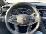 White[Crystal White Tricoat] 2021 Cadillac XT5 Premium Sport Steering Wheel and Dash Photo in Calgary AB