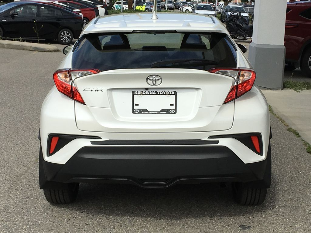 White[Blizzard Pearl] 2021 Toyota C-HR XLE Premium Rear of Vehicle Photo in Kelowna BC