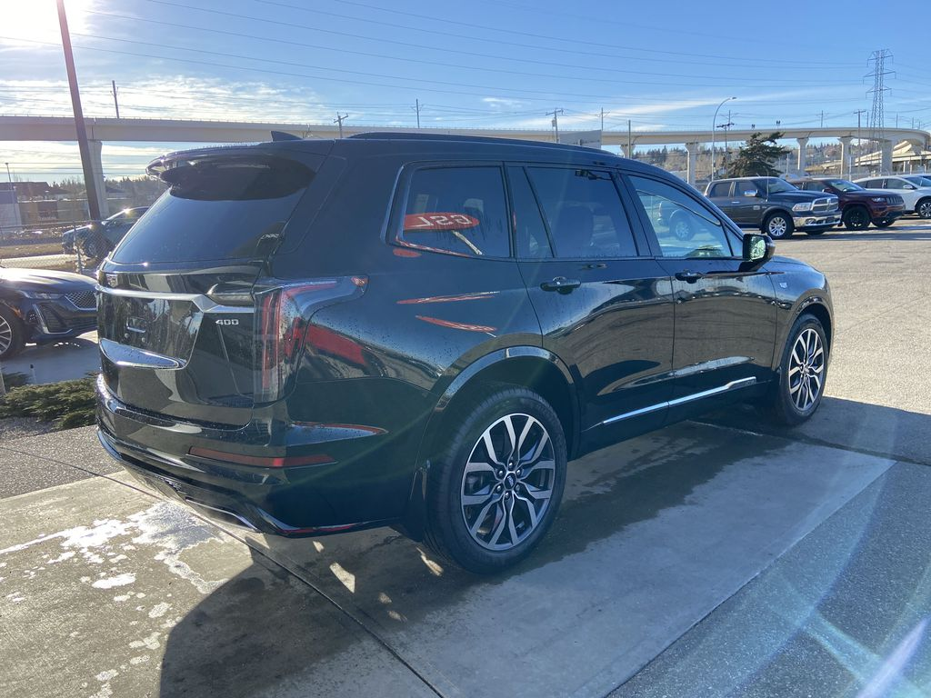 Black[Stellar Black Metallic] 2021 Cadillac XT6 Sport Right Rear Corner Photo in Calgary AB