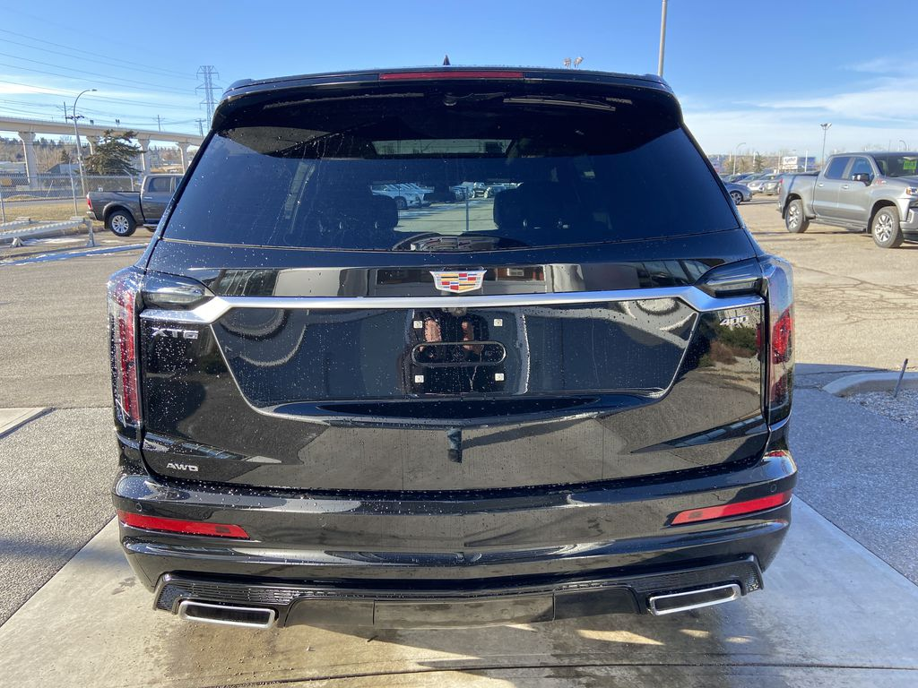 Black[Stellar Black Metallic] 2021 Cadillac XT6 Sport Rear of Vehicle Photo in Calgary AB