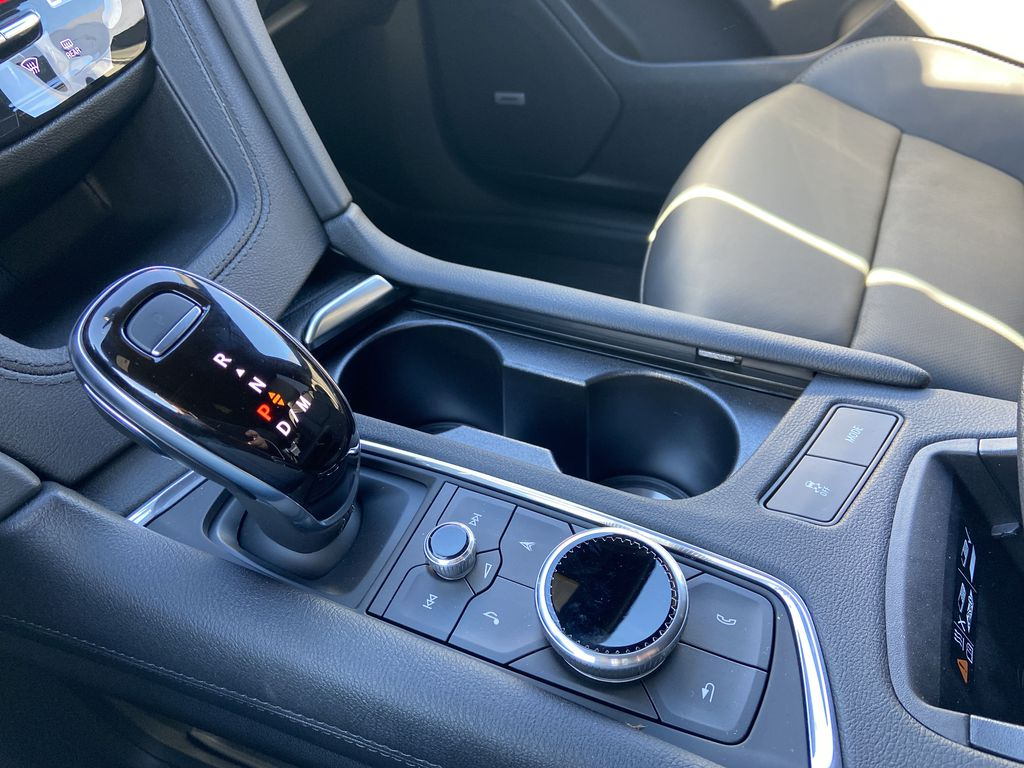 Black[Stellar Black Metallic] 2021 Cadillac XT6 Sport Center Console Photo in Calgary AB