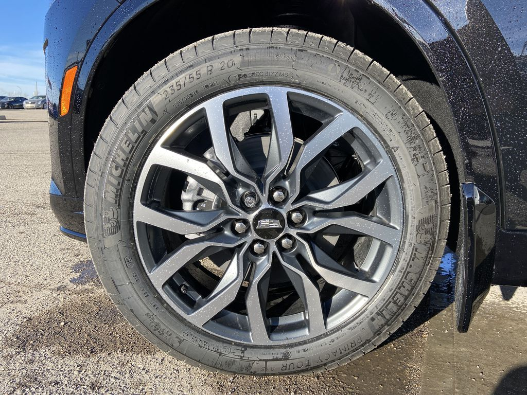 Black[Stellar Black Metallic] 2021 Cadillac XT6 Sport Left Front Rim and Tire Photo in Calgary AB