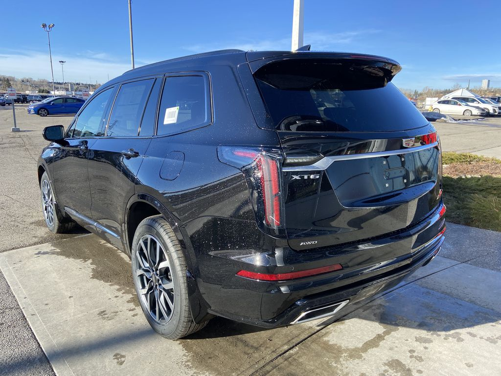 Black[Stellar Black Metallic] 2021 Cadillac XT6 Sport Left Rear Corner Photo in Calgary AB