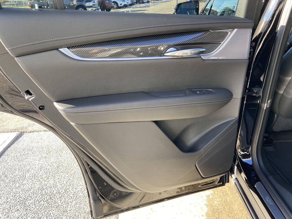 Black[Stellar Black Metallic] 2021 Cadillac XT6 Sport Left Rear Interior Door Panel Photo in Calgary AB