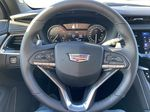 Black[Stellar Black Metallic] 2021 Cadillac XT6 Sport Steering Wheel and Dash Photo in Calgary AB