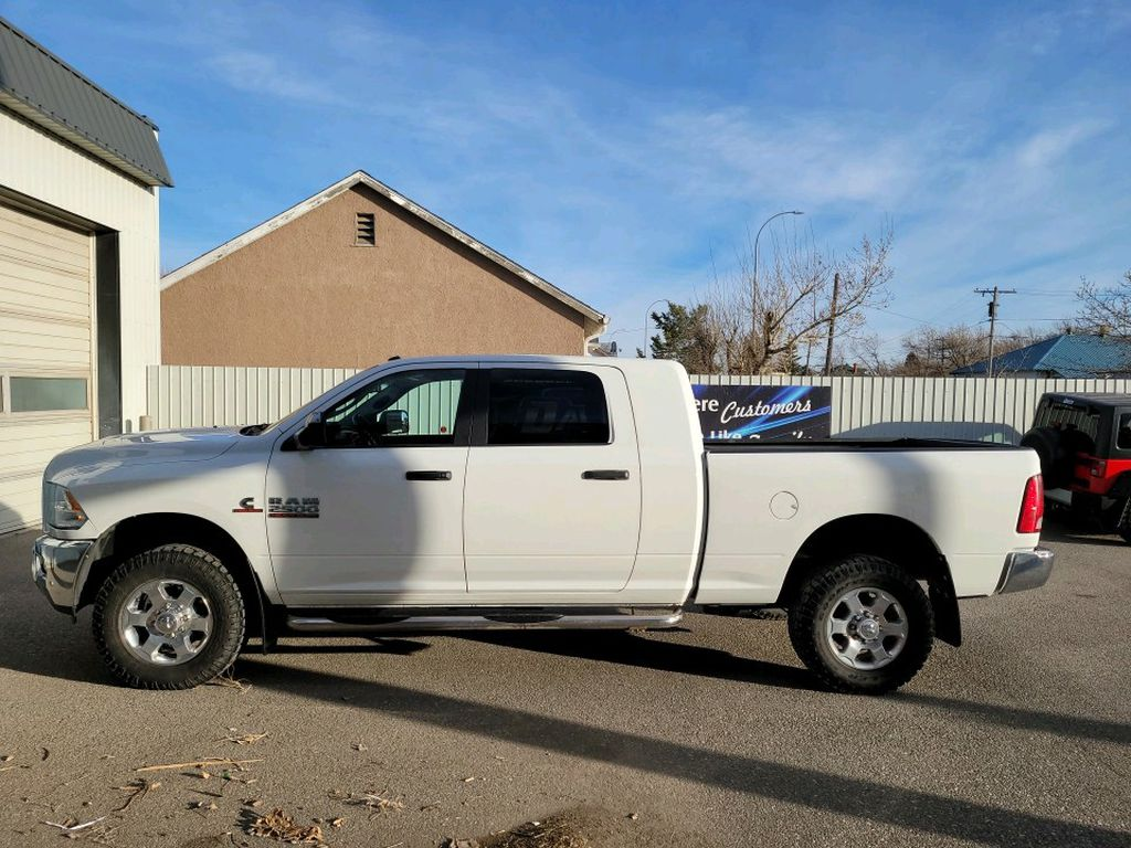 White 2017 Ram 2500 Left Front Interior Door Panel Photo in Fort Macleod AB