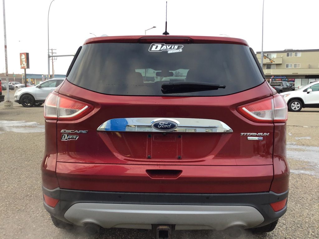Red 2014 Ford Escape Left Front Interior Door Panel Photo in Brooks AB