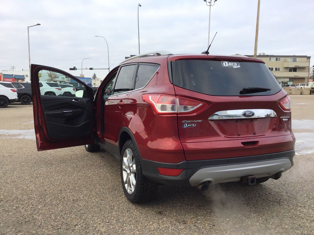 Red 2014 Ford Escape Left Front Rim and Tire Photo in Brooks AB