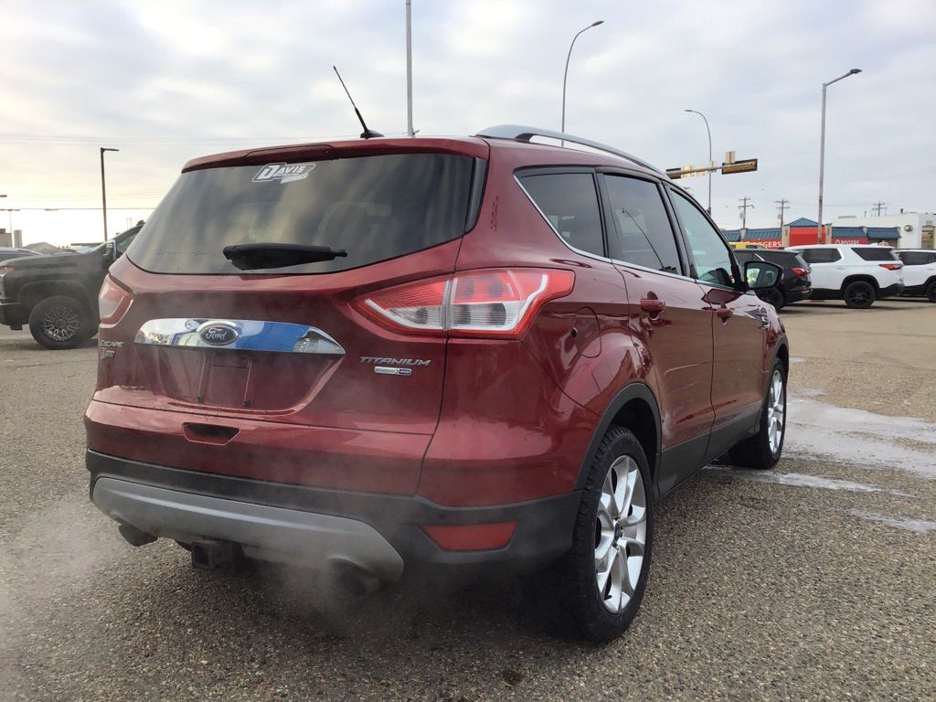 Red 2014 Ford Escape Left Front Interior Photo in Brooks AB
