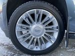 Silver[Radiant Silver Metallic] 2019 Cadillac Escalade Platinum Left Front Rim and Tire Photo in Calgary AB