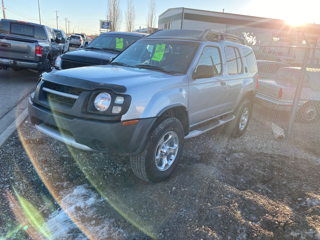 Silver[Silver Ice Metallic] 2003 Nissan Xterra Left Side Photo in Lethbridge AB