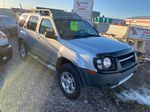 Silver[Silver Ice Metallic] 2003 Nissan Xterra Right Front Corner Photo in Lethbridge AB