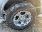 Silver[Silver Ice Metallic] 2003 Nissan Xterra Left Front Rim and Tire Photo in Lethbridge AB