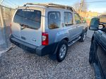 Silver[Silver Ice Metallic] 2003 Nissan Xterra Right Side Photo in Lethbridge AB