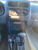 Silver[Silver Ice Metallic] 2003 Nissan Xterra Central Dash Options Photo in Lethbridge AB