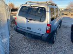 Silver[Silver Ice Metallic] 2003 Nissan Xterra Rear of Vehicle Photo in Lethbridge AB