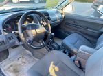 Silver[Silver Ice Metallic] 2003 Nissan Xterra Left Front Interior Photo in Lethbridge AB