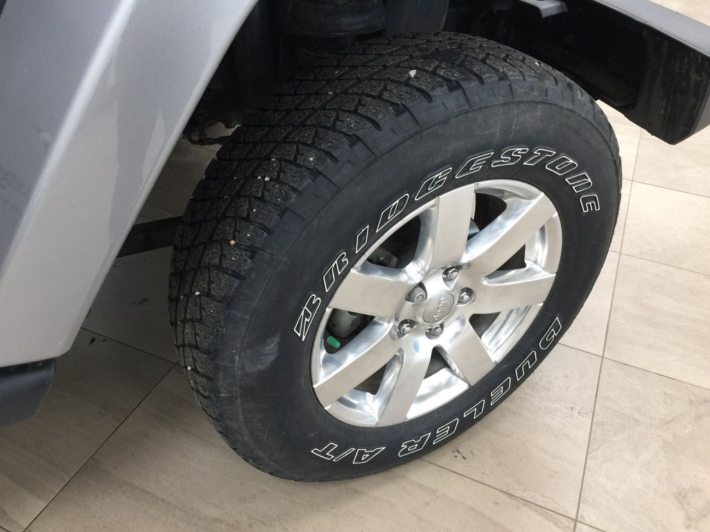 Silver[Billet Metallic] 2018 Jeep Wrangler JK Unlimited / Right Front Rim and Tire Photo in Sherwood Park AB