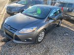 Gray[Sterling Grey Metallic] 2014 Ford Focus Left Side Photo in Lethbridge AB