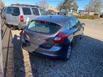 Gray[Sterling Grey Metallic] 2014 Ford Focus Rear of Vehicle Photo in Lethbridge AB