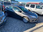 Gray[Sterling Grey Metallic] 2014 Ford Focus Right Side Photo in Lethbridge AB