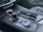 White[Crystal White Tricoat] 2021 Cadillac CT5 Sport Center Console Photo in Calgary AB