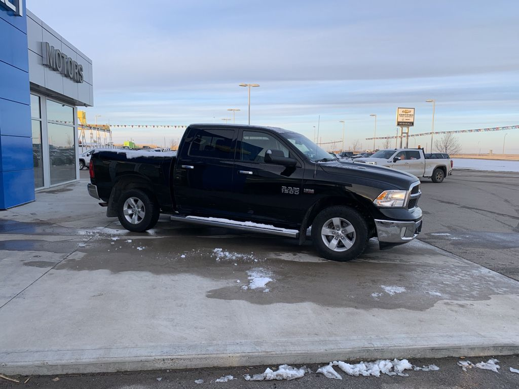Black[Black Clearcoat] 2014 Ram 1500 Left Front Rim and Tire Photo in Fort Macleod AB