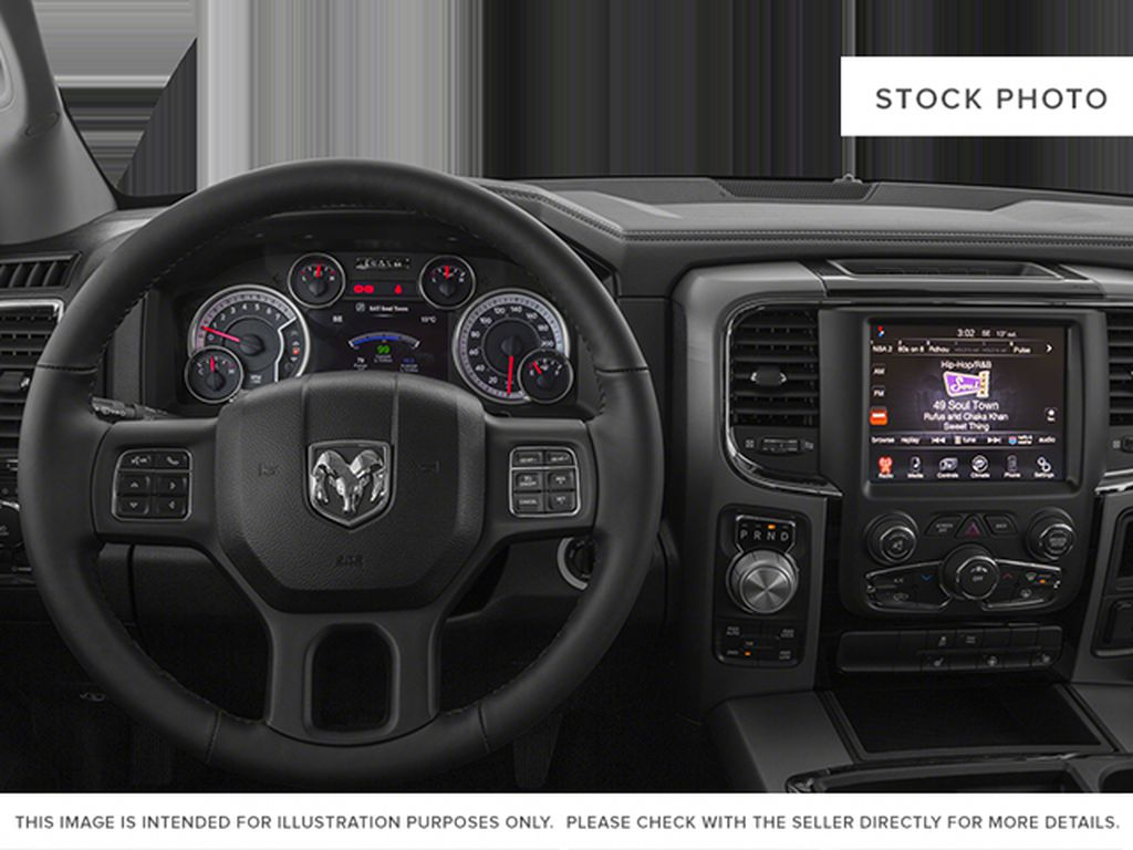 White[Bright White Clearcoat] 2014 Ram 1500 Steering Wheel and Dash Photo in Fort Macleod AB