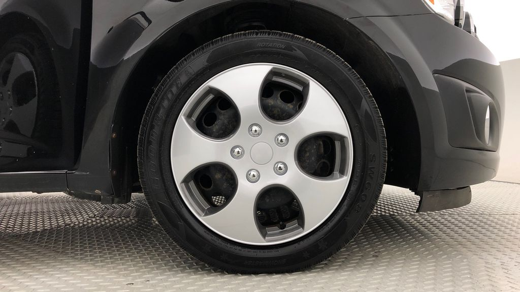 Black[Mosaic Black Metallic] 2016 Chevrolet Sonic LT - Automatic, Sunroof, 2 Sets Of Wheels Right Front Rim and Tire Photo in Winnipeg MB