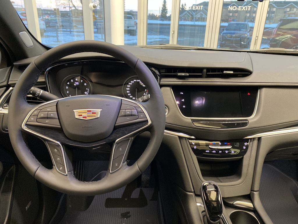 Red[Infrared Tintcoat] 2021 Cadillac XT5 Strng Wheel/Dash Photo: Frm Rear in Edmonton AB