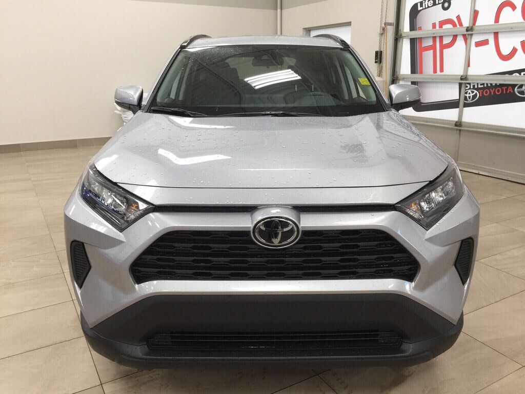 Silver[Silver Sky Metallic] 2021 Toyota RAV4 LE AWD Front Vehicle Photo in Sherwood Park AB