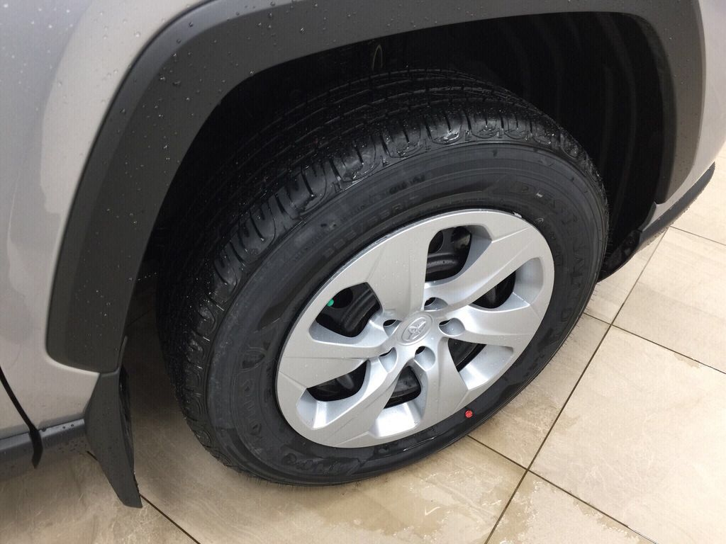 Silver[Silver Sky Metallic] 2021 Toyota RAV4 LE AWD Right Front Rim and Tire Photo in Sherwood Park AB