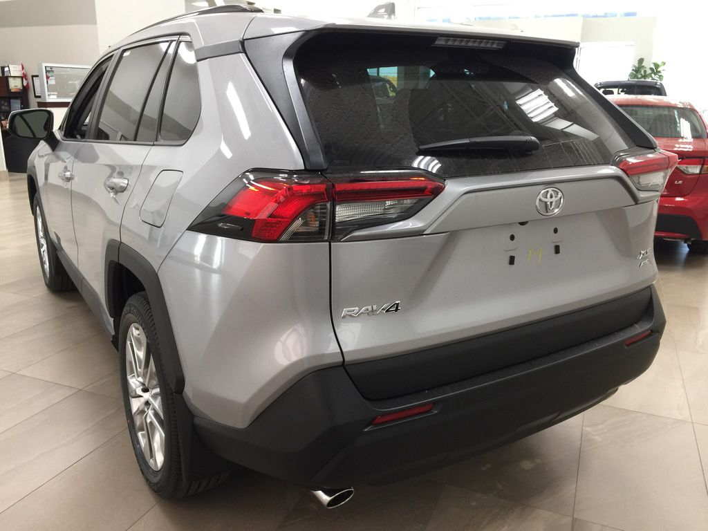 Silver[Silver Sky Metallic] 2021 Toyota RAV4 XLE Premium Left Rear Corner Photo in Sherwood Park AB