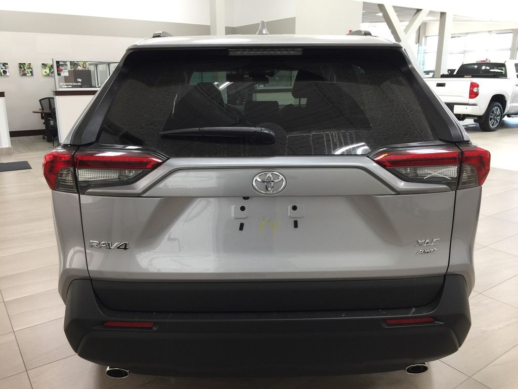 Silver[Silver Sky Metallic] 2021 Toyota RAV4 XLE Premium Rear of Vehicle Photo in Sherwood Park AB