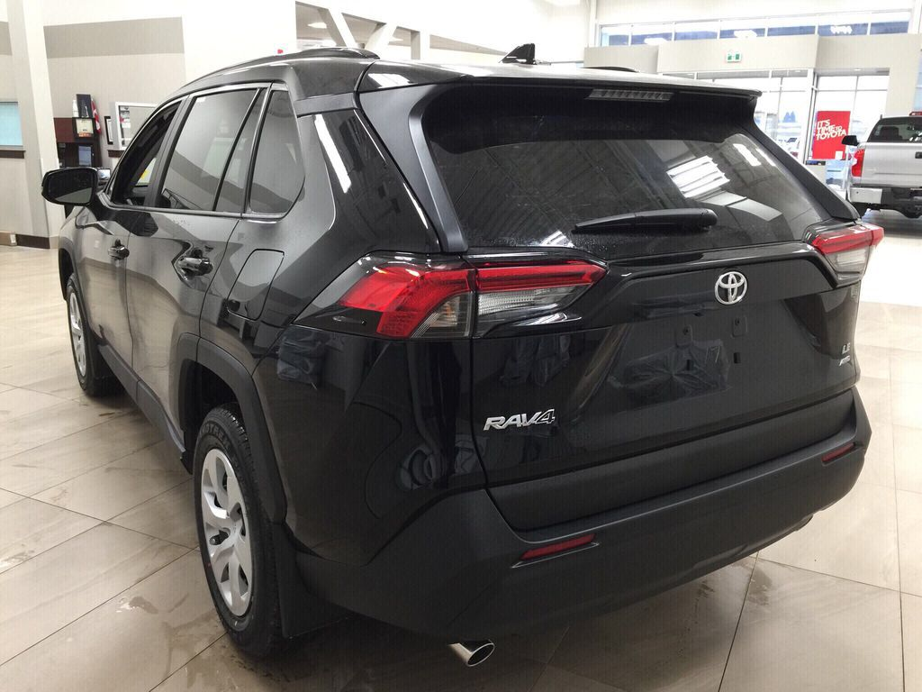 Black[Midnight Black Metallic] 2021 Toyota RAV4 LE AWD Left Rear Corner Photo in Sherwood Park AB