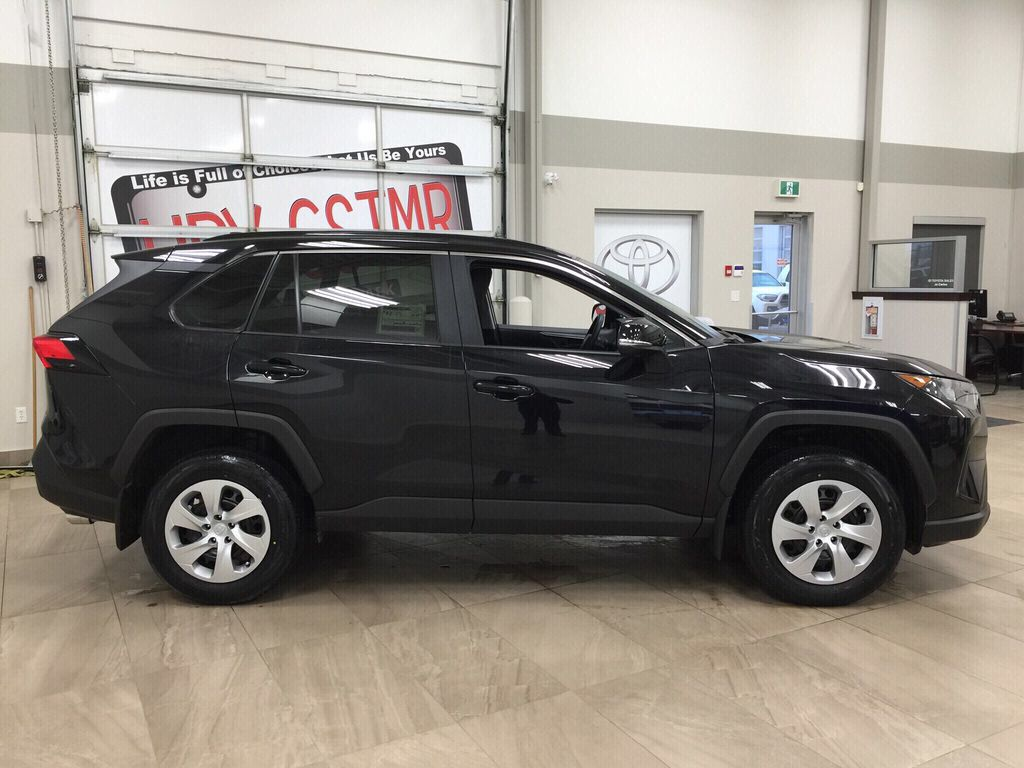 Black[Midnight Black Metallic] 2021 Toyota RAV4 LE AWD Right Side Photo in Sherwood Park AB