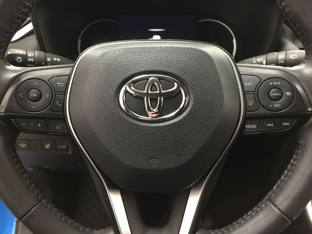 Blue[Blue Flame w/Ice Edge Roof] 2020 Toyota RAV4 Trail AWD Steering Wheel and Dash Photo in Sherwood Park AB