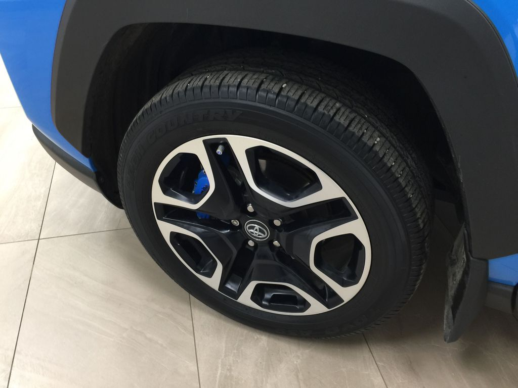 Blue[Blue Flame w/Ice Edge Roof] 2020 Toyota RAV4 Trail AWD Left Front Rim and Tire Photo in Sherwood Park AB