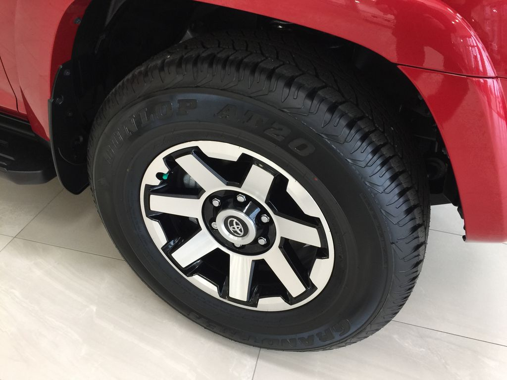 Red[Barcelona Red Metallic] 2021 Toyota 4Runner TRD Off-Road Right Front Rim and Tire Photo in Sherwood Park AB