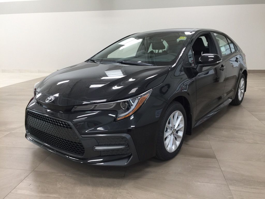 Black[Black Sand Pearl] 2021 Toyota Corolla SE Left Front Corner Photo in Sherwood Park AB