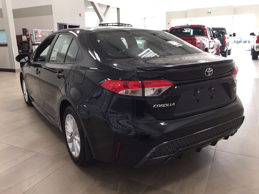 Black[Black Sand Pearl] 2021 Toyota Corolla SE Left Rear Corner Photo in Sherwood Park AB