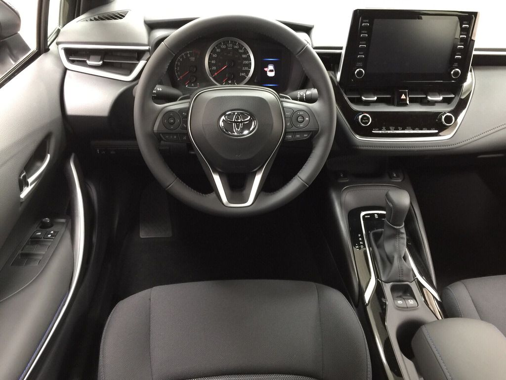 Black[Black Sand Pearl] 2021 Toyota Corolla SE Left Front Seat Photo in Sherwood Park AB