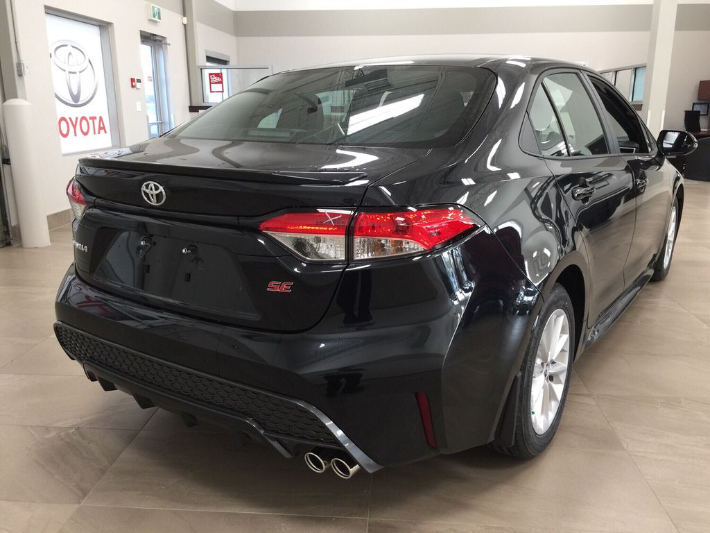 Black[Black Sand Pearl] 2021 Toyota Corolla SE Right Rear Corner Photo in Sherwood Park AB