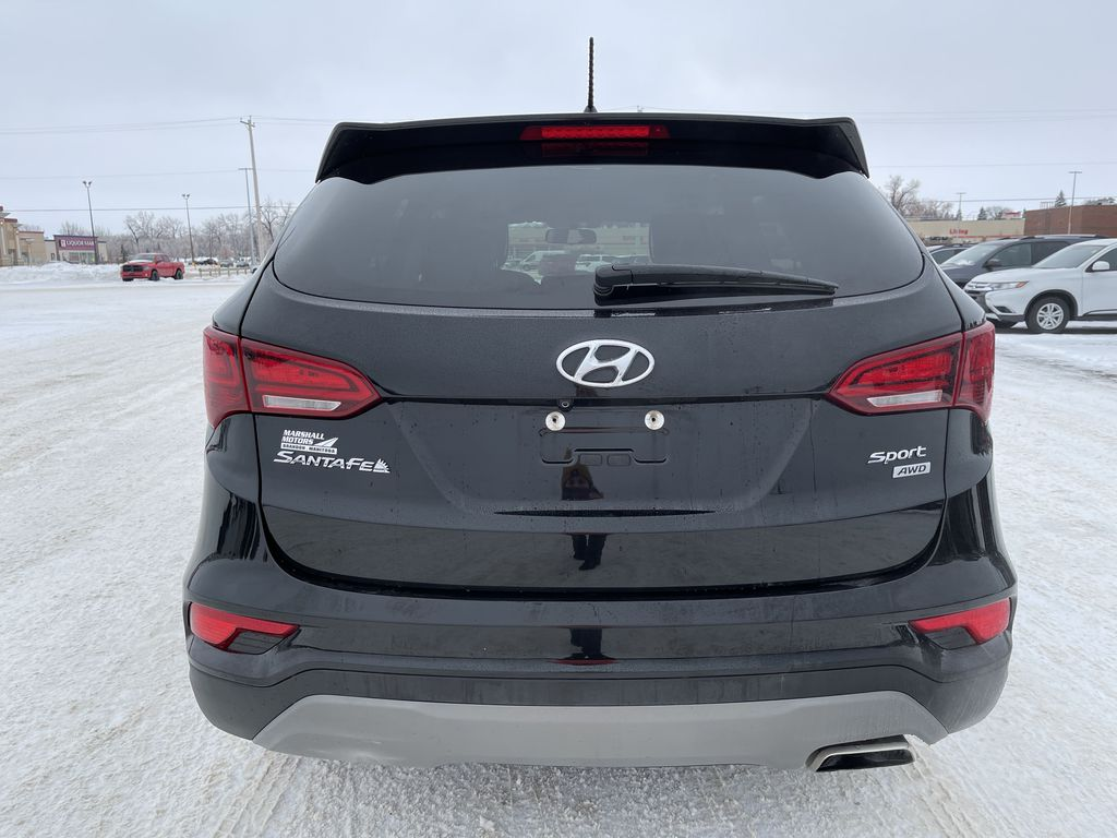 Black 2018 Hyundai Santa Fe Sport 2.4L AWD SPORT *Heated Seats*Backup Cam*Bluetooth* Rear of Vehicle Photo in Brandon MB