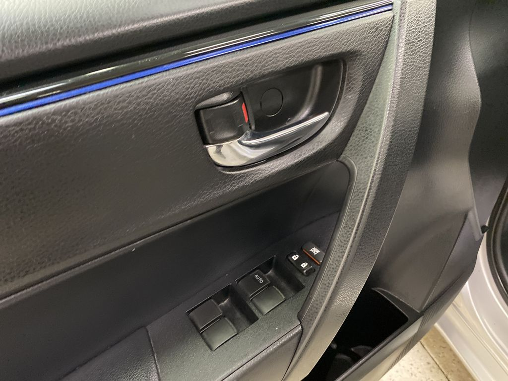 Silver[Classic Silver Metallic] 2018 Toyota Corolla  Driver's Side Door Controls Photo in Dartmouth NS