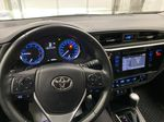 Silver[Classic Silver Metallic] 2018 Toyota Corolla Steering Wheel and Dash Photo in Dartmouth NS