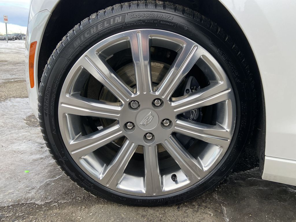White[Crystal White Tricoat] 2018 Cadillac ATS Sedan Luxury AWD Left Front Rim and Tire Photo in Calgary AB