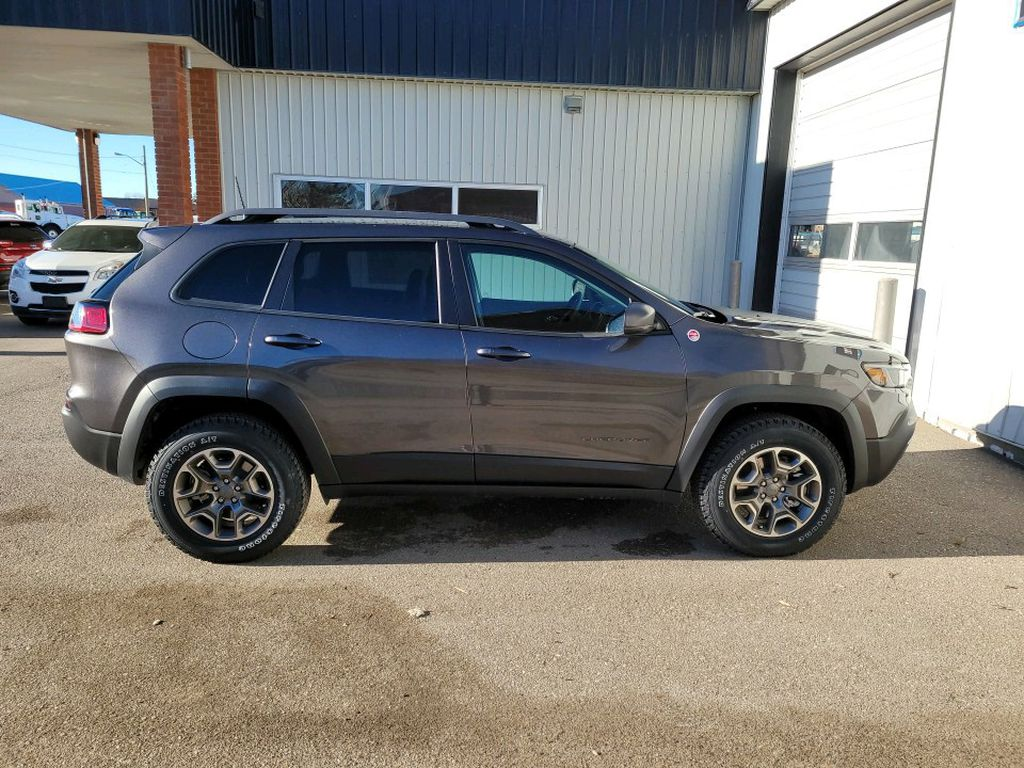 Grey 2021 Jeep Cherokee Left Front Interior Photo in Fort Macleod AB